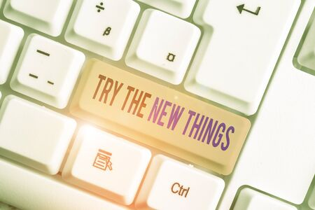 Text sign showing Try The New Things. Business photo text Breaks up Life Routine Learn some Innovative Skills White pc keyboard with empty note paper above white background key copy space