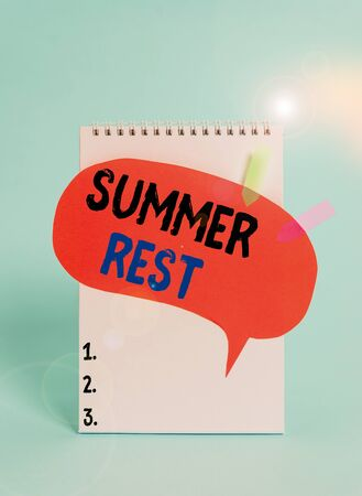 Text sign showing Summer Rest. Business photo text taking holiday break or unwind from work or school during summer Spiral notepad speech bubble arrow banners lying cool pastel background