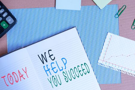 Handwriting text writing We Help You Succeed. Conceptual photo Aided Supported Funded someone to reach his dreams Striped paperboard notebook cardboard office study supplies chart paper