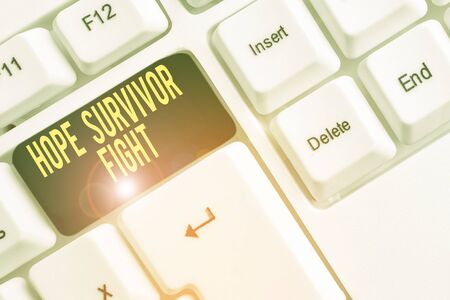 Conceptual hand writing showing Hope Survivor Fight. Concept meaning stand against your illness be fighter stick to dreams White pc keyboard with note paper above the white background Stockfoto