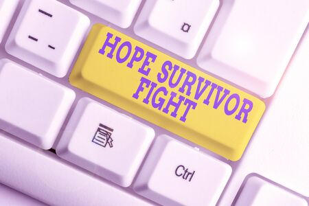 Text sign showing Hope Survivor Fight. Business photo text stand against your illness be fighter stick to dreams White pc keyboard with empty note paper above white background key copy space