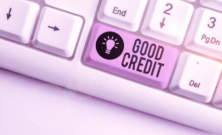 Text sign showing Good Credit. Business photo showcasing borrower has a relatively high credit score and safe credit risk White pc keyboard with empty note paper above white background key copy space Stok Fotoğraf