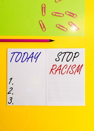 Handwriting text writing Stop Racism. Conceptual photo end the antagonism directed against someone of a different race Blank squared notebook pencil marker paper sheet plain colored background
