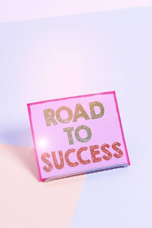 Word writing text Road To Success. Business photo showcasing studying really hard Improve yourself to reach dreams wishes Paper placed tilted above buffer wire on soft pastel multi colours backdrop Stockfoto