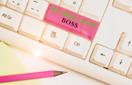 Writing note showing Be Your Own Boss. Business concept for Entrepreneurship Start business Independence Selfemployed White pc keyboard with note paper above the white background Imagens
