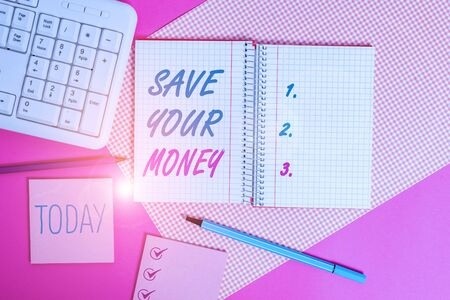 Handwriting text writing Save Your Money. Conceptual photo keep your savings in bank or stock to protect it Dont waste Writing equipments and computer stuffs placed above colored plain table