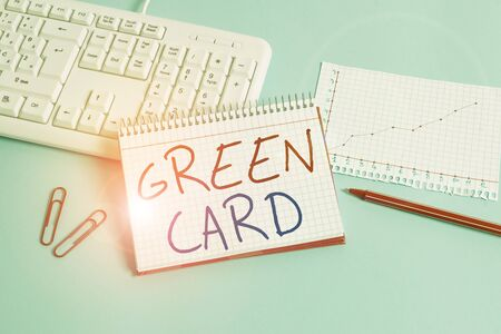 Conceptual hand writing showing Green Card. Concept meaning permit allowing a foreign national to live peranalysisently in the US Paper blue keyboard office study notebook chart numbers memo
