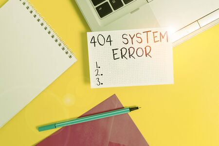 Conceptual hand writing showing 404 System Error. Concept meaning message appears when website is down and cant be reached Laptop marker square sheet spiral notebook color background Stockfoto