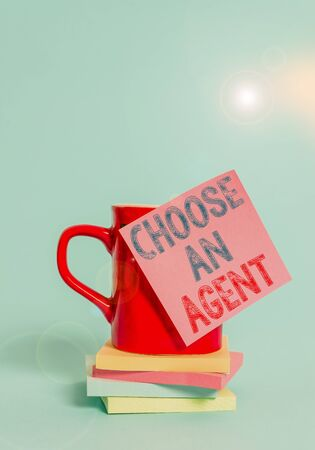 Conceptual hand writing showing Choose An Agent. Concept meaning Choose someone who chooses decisions on behalf of you Coffee cup colored sticky note stacked pads plain background