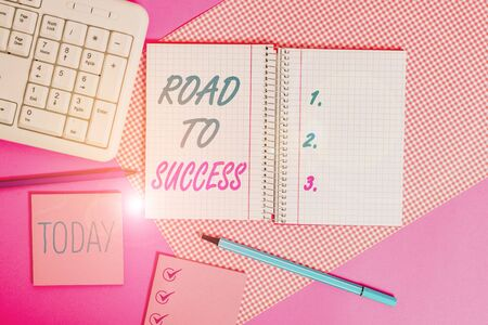 Handwriting text writing Road To Success. Conceptual photo studying really hard Improve yourself to reach dreams wishes Writing equipments and computer stuffs placed above colored plain table Stockfoto