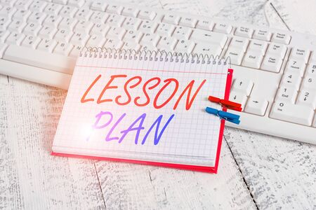 Handwriting text writing Lesson Plan. Conceptual photo a teacher s is detailed description of the course of instruction notebook paper reminder clothespin pinned sheet white keyboard light wooden Banco de Imagens