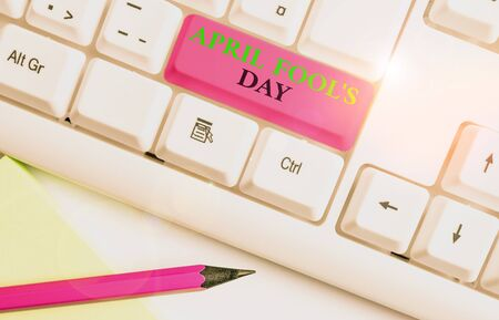 Writing note showing April Fool S Day. Business concept for Practical jokes humor pranks Celebration funny foolish White pc keyboard with note paper above the white background Reklamní fotografie
