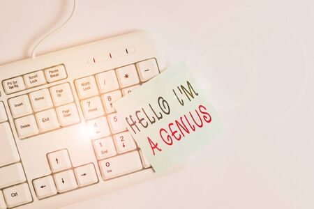 Writing note showing Hello I M A Genius. Business concept for Introduce yourself as over average demonstrating to others White pc keyboard with empty note paper above white background Stock fotó