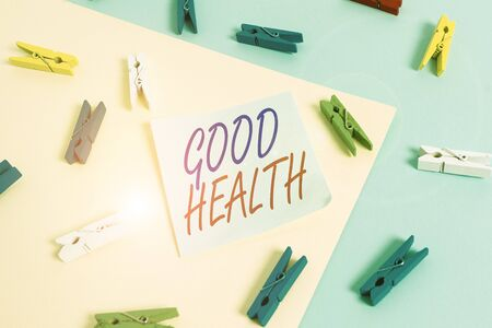 Text sign showing Good Health. Business photo showcasing state of being vigorous and free from bodily or mental disease Colored clothespin paper empty reminder yellow blue floor background office