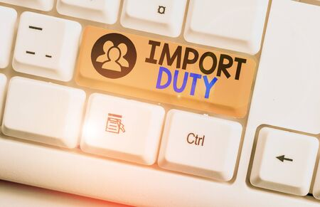 Text sign showing Import Duty. Business photo text tax imposed by a government on goods from other countries White pc keyboard with empty note paper above white background key copy space