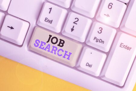 Conceptual hand writing showing Job Search. Concept meaning An act of demonstrating to find work suited for his profession White pc keyboard with note paper above the white background