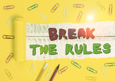 Word writing text Break The Rules. Business photo showcasing Make changes do everything different Rebellion Reform Stationary and torn cardboard placed above a wooden classic table backdrop