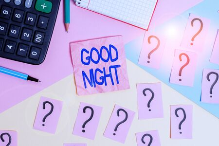 Handwriting text Good Night. Conceptual photo expressing good wishes on parting at night or before going to bed Mathematics stuff and writing equipment above pastel colours background