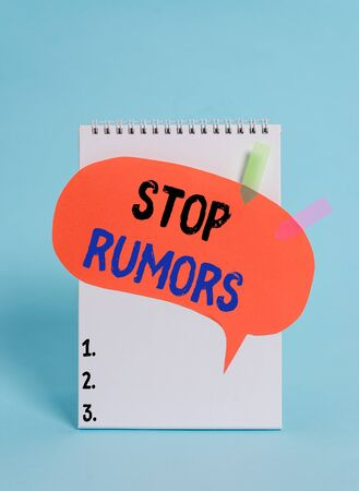 Text sign showing Stop Rumors. Business photo text put an end circulating the story of uncertain or doubtful truth Spiral notepad speech bubble arrow banners lying cool pastel background 免版税图像