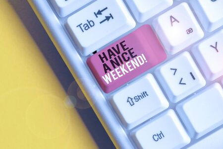 Text sign showing Have A Nice Weekend. Business photo text wishing someone that something nice happen holiday White pc keyboard with empty note paper above white background key copy space