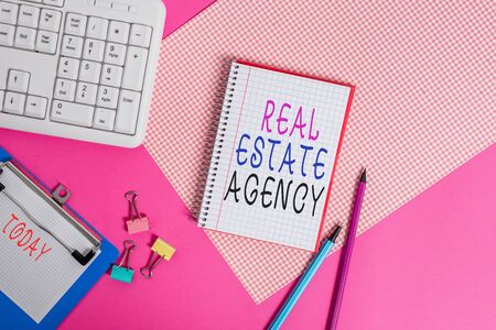 Conceptual hand writing showing Real Estate Agency. Concept meaning Business Entity Arrange Sell Rent Lease Manage Properties Writing equipments and computer stuff placed on plain table