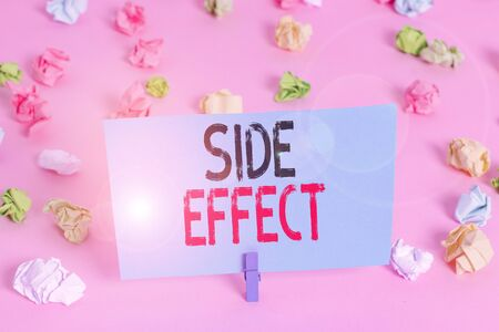 Handwriting text Side Effect. Conceptual photo typically undesirable effect of a drug or medical treatment Colored crumpled papers empty reminder pink floor background clothespin