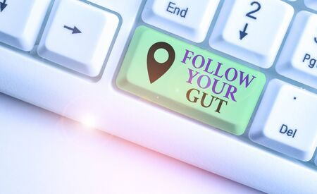 Writing note showing Follow Your Gut. Business concept for Listen to intuition feelings emotions conscious perception