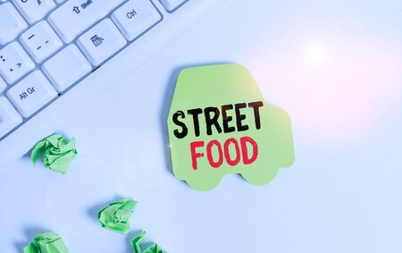 Handwriting text writing Street Food. Conceptual photo cooked food sold by vendors in a street or other public location Green note paper in the shape of the car. Copy space on the green note paper