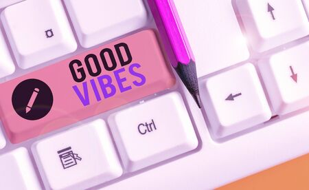 Writing note showing Good Vibes. Business concept for slang phrase for the positive feelings given off by a demonstrating