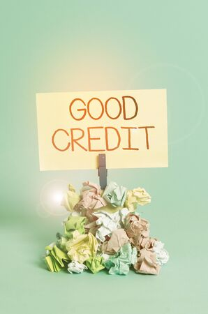 Word writing text Good Credit. Business photo showcasing borrower has a relatively high credit score and safe credit risk Reminder pile colored crumpled paper clothespin reminder blue background