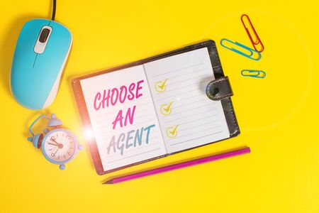 Word writing text Choose An Agent. Business photo showcasing Choose someone who chooses decisions on behalf of you Locked diary sheets clips marker mouse alarm clock colored background