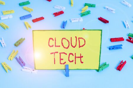 Word writing text Cloud Tech. Business photo showcasing storing and accessing data and programs over the Internet Colored clothespin papers empty reminder blue floor background office pin