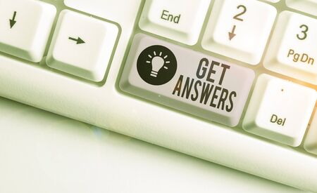 Text sign showing Get Answers. Business photo showcasing to get a reply or something when asks a question to someone White pc keyboard with empty note paper above white background key copy space Stok Fotoğraf - 133726086