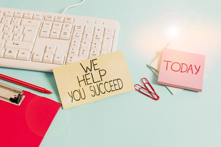 Word writing text We Help You Succeed. Business photo showcasing Aided Supported Funded someone to reach his dreams Paper blue desk computer keyboard office study notebook chart numbers memo