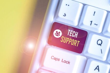 Text sign showing Tech Support. Business photo text advising and troubleshooting service provided by a analysisufacturer White pc keyboard with empty note paper above white background key copy space