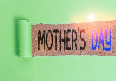 Text sign showing Mother S Day. Business photo text a celebration honoring the mother of the family or motherhood Cardboard which is torn in the middle placed above a wooden classic table 写真素材