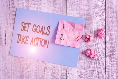 Word writing text Set Goals Take Action. Business photo showcasing Act on a specific and clearly laid out plans Wrinkle paper and cardboard plus stationary placed above wooden background Stock Photo