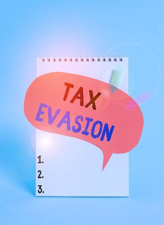Text sign showing Tax Evasion. Business photo text the failure to pay or the deliberate underpayment of taxes Spiral notepad speech bubble arrow banners lying cool pastel background Stock Photo