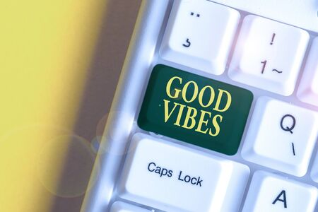 Handwriting text Good Vibes. Conceptual photo slang phrase for the positive feelings given off by a demonstrating White pc keyboard with empty note paper above white background key copy space