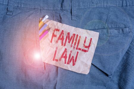 Word writing text Family Law. Business photo showcasing the branch of law that deals with matters relating to the family Writing equipment and brown note paper inside pocket of man work trousers