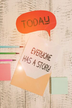 Writing note showing Everyone Has A Story. Business concept for Background storytelling telling your memories tales Envelop speech bubble paper sheet ballpoints notepads wooden background