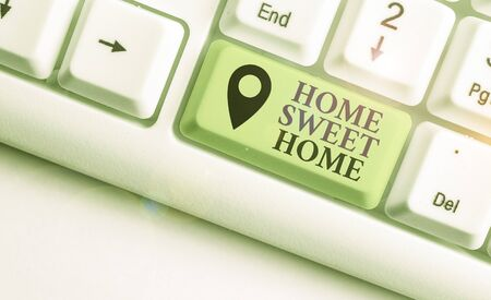 Writing note showing Home Sweet Home. Business concept for In house finally Comfortable feeling Relaxed Family time