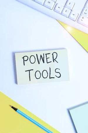 Text sign showing Power Tools. Business photo showcasing tool that is actuated by additional power source and mechanism Flat lay above table with pc keyboard and copy space paper for text messages Reklamní fotografie