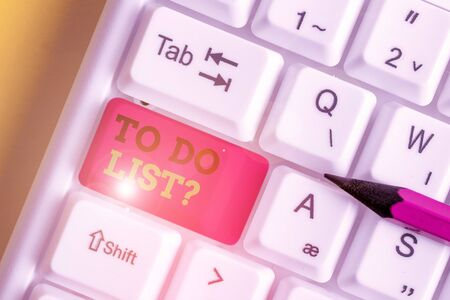 Handwriting text writing To Do List Question. Conceptual photo Series of task to be done organized in priority order White pc keyboard with empty note paper above white background key copy space