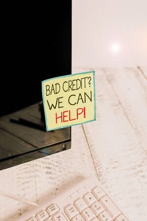 Handwriting text Bad Credit Question We Can Help. Conceptual photo offering help after going for loan then rejected Notation paper taped to black computer monitor screen near white keyboard Stok Fotoğraf