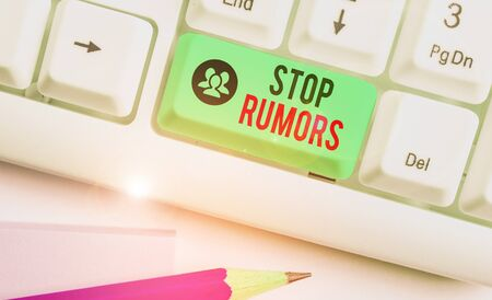Writing note showing Stop Rumors. Business concept for put an end circulating the story of uncertain or doubtful truth