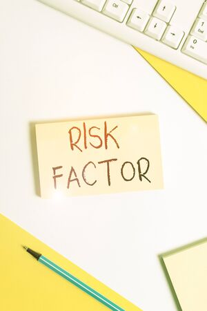 Text sign showing Risk Factor. Business photo showcasing a condition behavior or other factor that increases danger Flat lay above table with pc keyboard and copy space paper for text messages Stockfoto