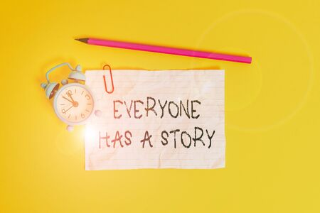 Conceptual hand writing showing Everyone Has A Story. Concept meaning Background storytelling telling your memories tales Metal alarm clock ccrushed sheet pencil colored background
