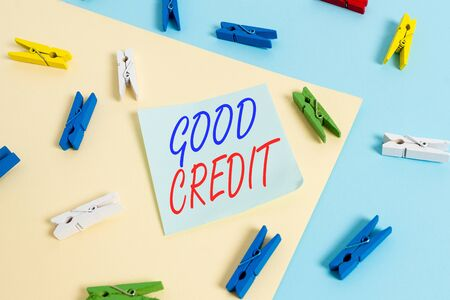 Text sign showing Good Credit. Business photo showcasing borrower has a relatively high credit score and safe credit risk Colored clothespin paper empty reminder yellow blue floor background office