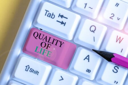 Conceptual hand writing showing Quality Of Life. Concept meaning being in good health decent job Enjoying every moment White pc keyboard with note paper above the white background